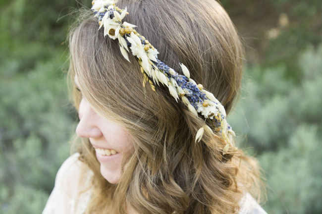 Girl wearing a flower crown made by Paula Jean's Garden from Etsy
