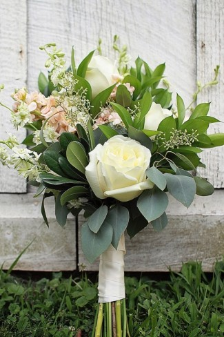Bridal Bouquets with white roses, white delphinium, seeded eucalyptus, italian ruscus with peach stock