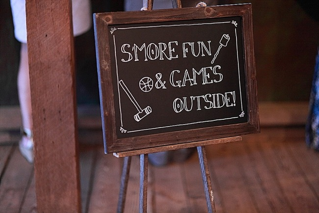 """Smore fun and games outside"" sign at wedding ceremony"