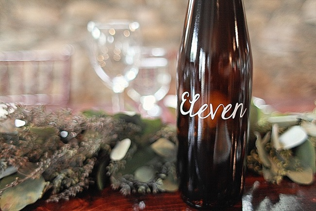 Wine bottle for table number