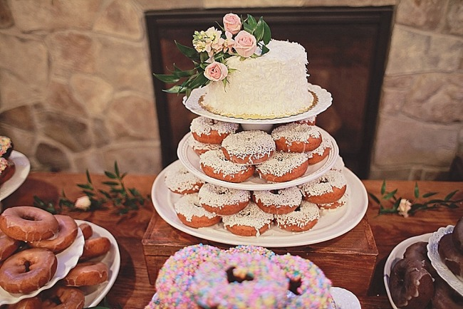 One tier wedding cake with donuts underneath