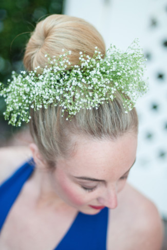 Women wearing a bun in her hair with a baby's breath floral crown