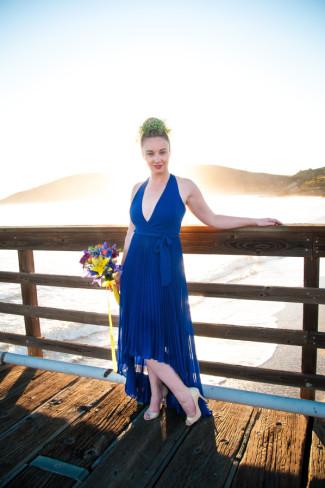 girl standing on dock of Avila Beach wearing a floral crown