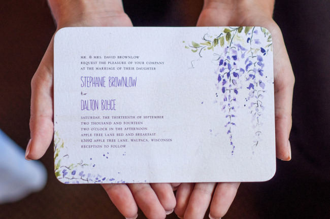 Purple floral wedding invitation by Wedding Paper Divas.