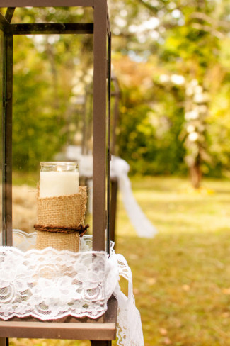 Tall lantern for outdoor wedding reception aisle decor