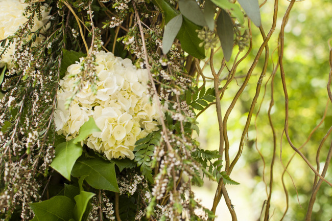 White hydrangeas for ceremony arch way decor