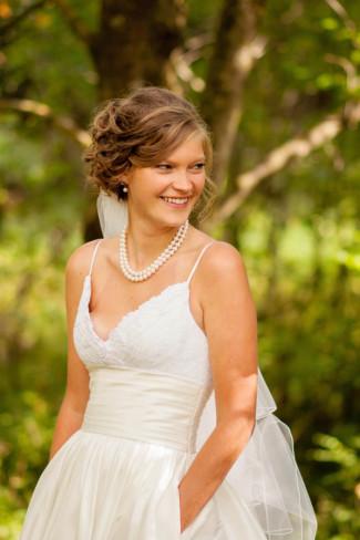 Bride wearing a spaghetti strap maggie sottero gown