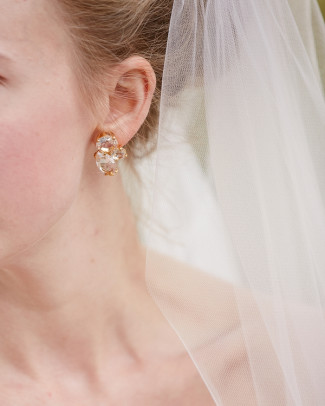 Bride wearing heart shaped diamond earrings