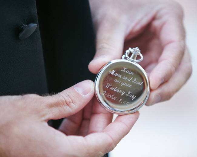Parents give an old pocket watch for a wedding gift to their son