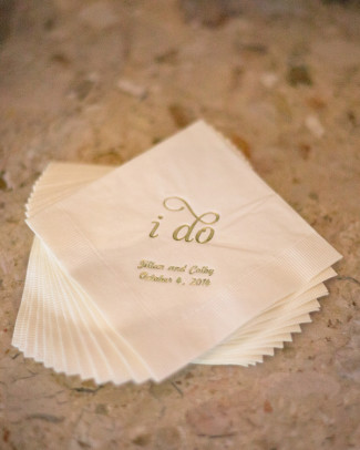 "White napkins with ""i do"" written in gold"