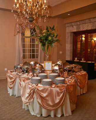Wedding reception buffet table at Tate House Mansion with pink table cloths