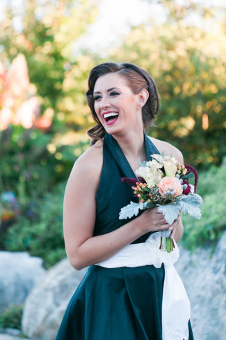 laughing styled shoot model with bouquet