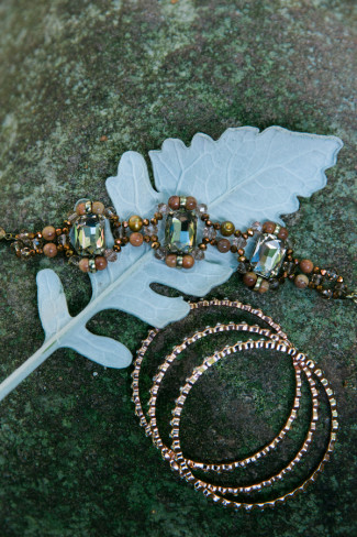 Dusty Miller leaf with jewelry on top