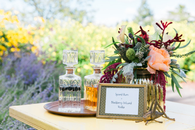 outdoor styled shoot decanter and floral centerpiece at Boothbay Botanical Gardens
