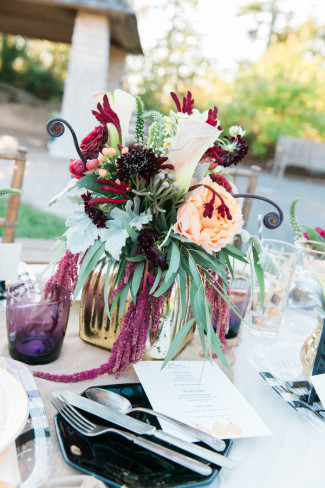 Bright and bold wedding floral center piece created by Queen Anne's Flower Shop