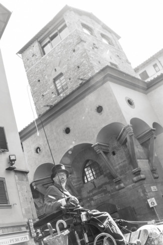 Man driving a horse drawn buggy in the streets of Florence