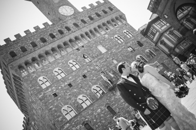 Bride and groom kissing in the streets of Florence Italy after wedding ceremony