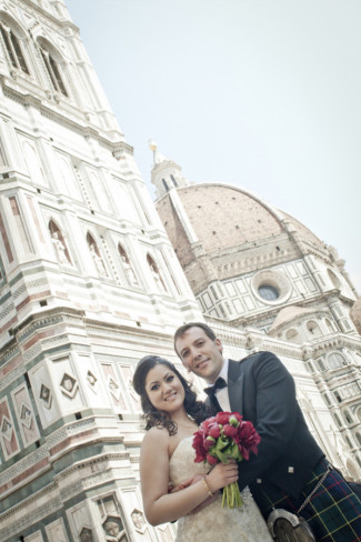 Bride and groom posing in front of the Duomo in Florence Italy