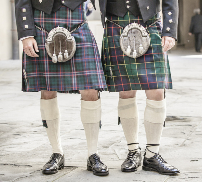 Groom and bestman wearing traditional Scottish kilts