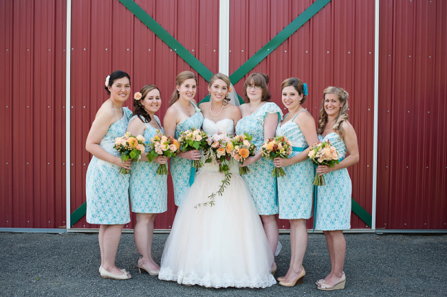 bridesmaids wearing teal dresses with ivory lace overlay made by Mori Lee