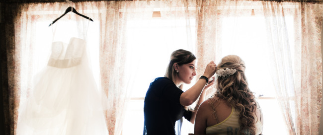 Bride getting ready for wedding at the manor house