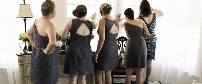 Bridesmaids wearing yellow mismatched dresses