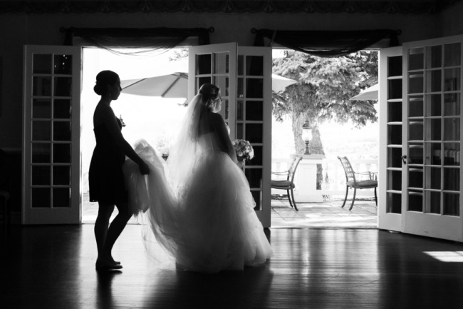 Black and white photo of bride waiting to walk down aisle at The Manor House