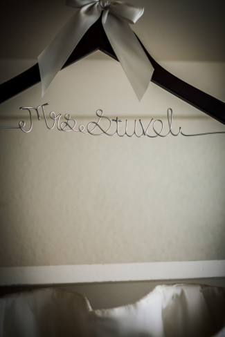 wedding dress hanger with brides new last name molded out of metal