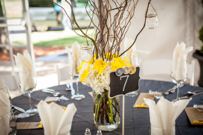 Yellow and white floral center piece with twigs