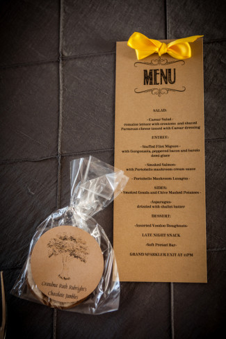Grey table cloth with rustic menu and homemade wedding favor cookies