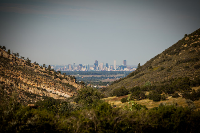 Picture of Denver Colorado between the mountains