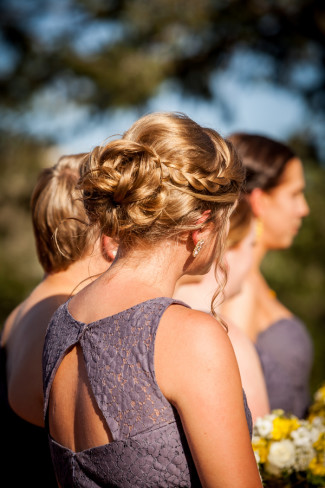 Bridesmaids wearing grey mismatched gowns during wedding ceremony