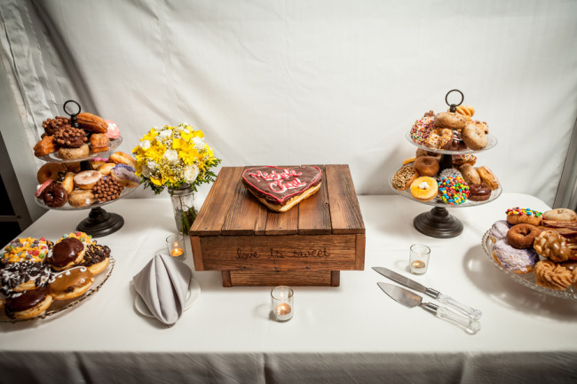 Wedding reception dessert table with donuts