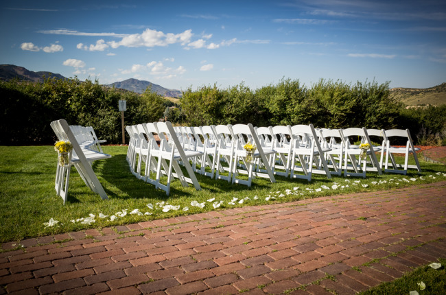 White chairs for outdoor wedding ceremony at The Manor House in Colorado