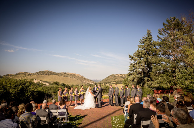 Yellow and grey outdoor wedding ceremony at The Manor House