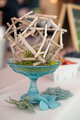 wooden sphere diy in a blue glass vase for wedding reception center piece