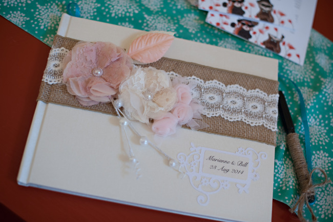 wedding guestbook with rustic burlap and blush pink lace flowers