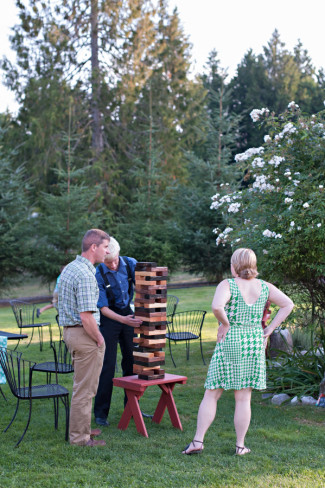 Wedding guests playing large jenga