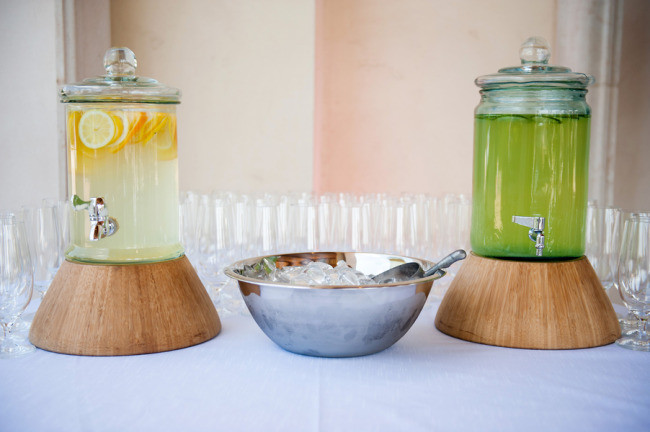 jugs with lemonade and glasses on table