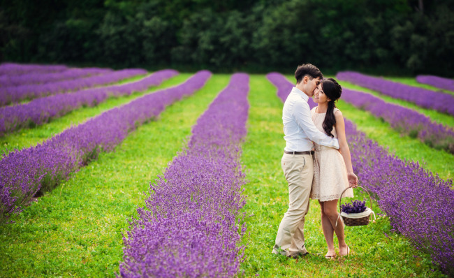 Couple standing in between Lavender for engagement shoot