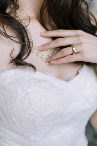 Bride wearing neclace by ann klein and ring by David Rice Jewelry