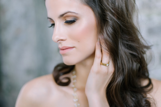 Bride wearing a solitair ring by David Rice Jewelry