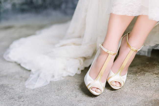 bride wearing white and gold Nine West t-strap shoes