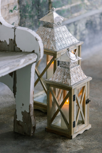 cream color morocan lantern with candles