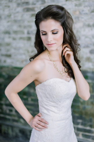 Bride wearing sweetheart neckline and wearing a engagement ring by David Rice Jewelry