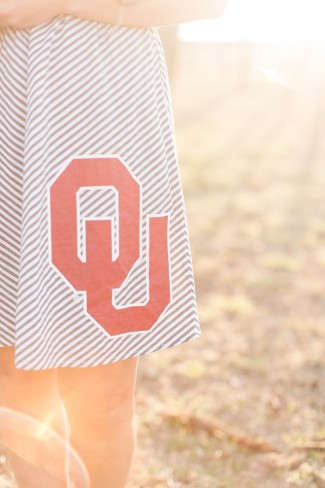 """letters """"OU"""" on skirt"""