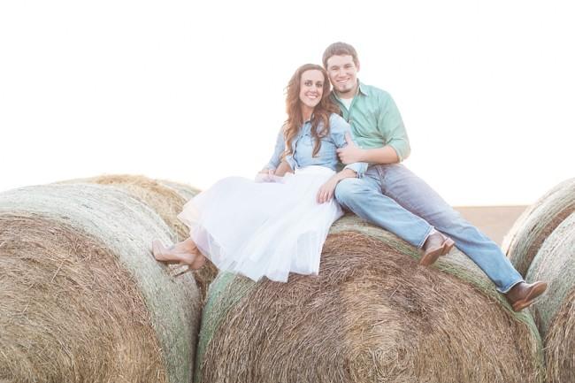 sitting ontop of hay stacks