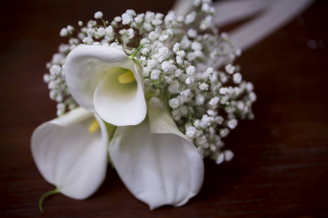 Bridal bouquet of white lilies and baby's breath