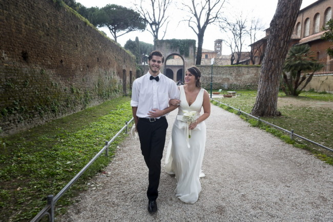 Bride walking down aisle at Aventine Hill with her brother