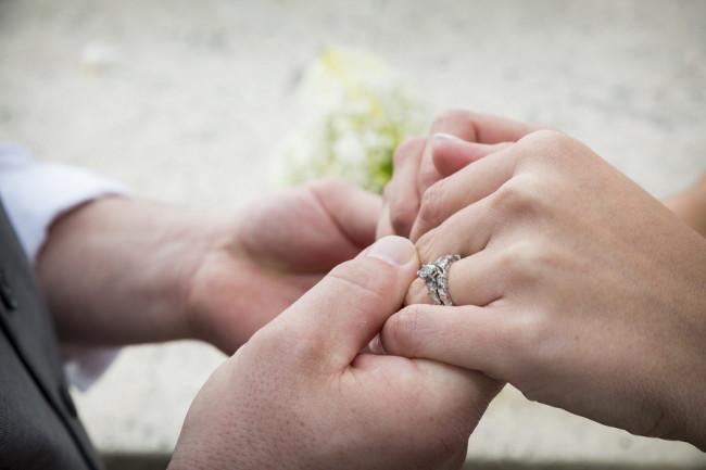 Tear drop shaped diamond ring on bride finger